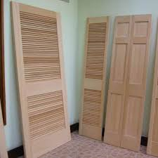 solid wood louvered closet doors howling 32 inch bifold