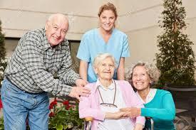Geriatric Nursing Group Of Seniors With Geriatric Nurse In Nursing Home Or Nursing