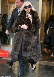 unfurgetable lady gaga looked elegant in a brown faux fur coat while taking a