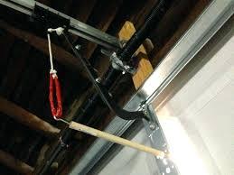 open garage door from outside gently pull toward you to release the mechanisms latch and then open garage door