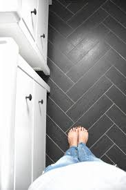 classic gray white and black bathroom with herringbone tile floors home decor on