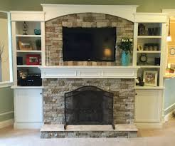Homemade fireplace and built-in bookshelves utilizing Airstone vernier  stones and a