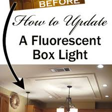 how to remove and replace a large fluorescent light box from your kitchen and update it with light and bright lighting options