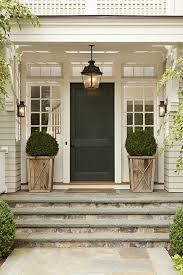 front door lighting ideas. front porch white pots flanking each side stone steps door with transom lighting ideas