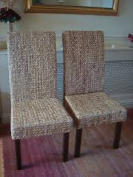 new never used pair of rattan dining chairs walnut stain argos