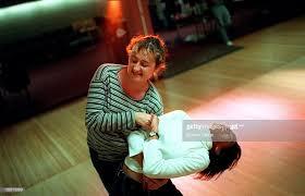 Katarzyna Razynska dances with Priscilla Austin, bottom, after their...  News Photo - Getty Images