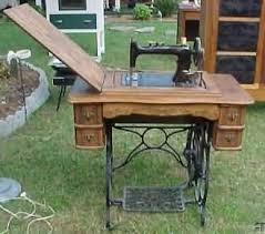 1880's Wheeler sewing machine--the machine drops into the bottom cabinet so  that it
