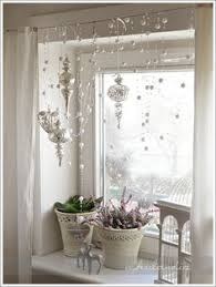 Festive ornaments & garland hanging in front of your windows!