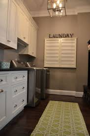 Smaller drawers for junk, laundry hamper, utility sink and shorter cabinet  with rod for top load washer and hanging clothes from dryer.