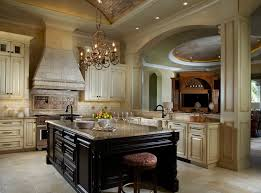 Tuscan Style Kitchen Design L Shaped Kitchen Counter Beige Cabinets  Colorful Backsplash Classic Chandelier Over Island