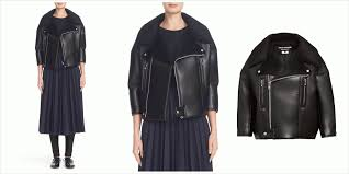 the jacket with its biker inspired style is made from smooth faux leather the cropped silhouette is framed with shortened sleeves and detailed silver tone