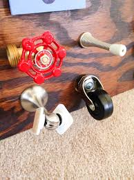 wheel and magnetic doorstop on toddler busy board