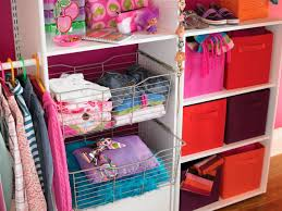 baby closet organizers and single hanging clothes area also two iron basket boxes plus colorful basket boxes on varnished hardwood floor and sweet fuchsia