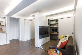 small apartment with motorized wall rotating tv