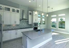 gorgeous kitchen with crisp white cabinetry marble and black grey tile backsplash cabinets