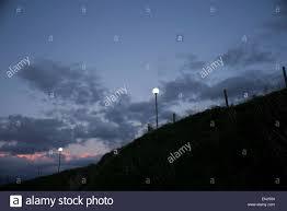 Street Lights In Villages Street Lights In Remote Coastal Village Evening Sky Clouds