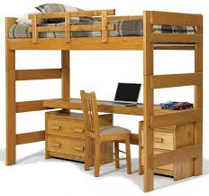 This rich natural wood bed features a single bunk above a lengthy desk,  with additional