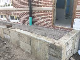the wheelchair ramp into the main entrance of the building is being installed photo credit