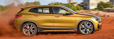 2018 bmw 0 60. perfect 2018 side view of yellow 2018 bmw x2 driving by a factory on bmw 0 60