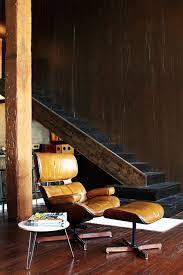 vintage eames mid century modern cabin carmel leather chair in dark den 10