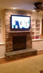 stone fireplace with tv over fireplace tv installation stone decorating remodeling