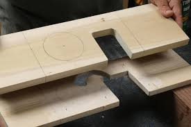 then sand the bottom it helps to clamp the board on edge use a 1 2 in dowel to form smooth curves at the bottom edges and then a narrow block to flatten