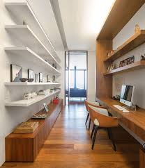 desk home office 2017. In This Home Office Built For Two, Wood Shelving And Long Desk Are On One Side, While Floating White Shelves Books Decorative Displays Sit The 2017