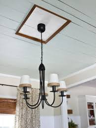 iron chandelier with ceiling medallion