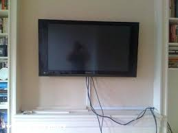 hang tv on wall mount tv plaster wall above fireplace