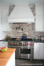 View in gallery Brick backsplash white cabinets