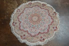 handmade round silk turkish hereke rug