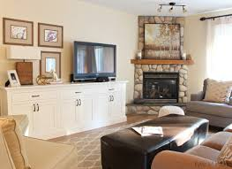 gorgeous awkward living room layout with corner fireplace in living