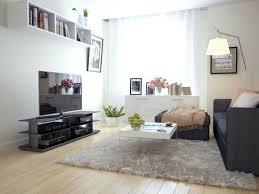 area rug with brown couch living room fancy chandelier purple carpet standing floor lamp rustic table area rug with brown couch