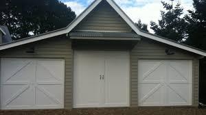 garage barn doorsBarn Style Overhead Garage Door With False Hinges Matching With