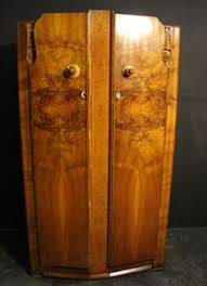 declaration large art deco figured walnut double door wardrobe has been declared an antique and is approved for sale on sellingantiquescouk art deco figured walnut wardrobe vintage