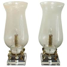 pair of seeded glass electrified hurricane lamps for