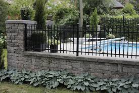 field stone wall with ornamental iron