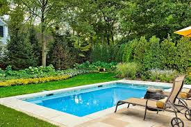 Lovely Small Swimming Pools Designs with Cute Sunbathe Chair on Floor plus  Yellow Umbrella