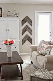 view in gallery diy wooden arrows bring some interesting wall art to this living room