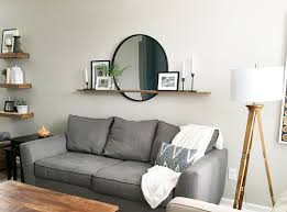how to decorate a large wall over a sofa