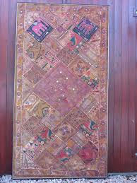 indian patchwork wall hanging framed made from old gujarati hand embroidered dresses