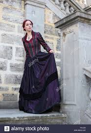 Beautiful Portrait Of A Beautiful Red Haired Girl Wearing Gothic Inspired Victorian  Era Clothes. Vampire Or