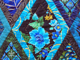 Wendy's quilts and more: Bordered Diamonds becomes Bordered Peacocks & I love these blue flowers in the Peacock fabric Adamdwight.com