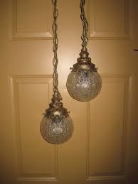 this is a lovely old lighting fixture that would add vintage charm to any room the beautiful glass globes are about in diameter and the chains measure