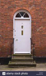 Decorating circular door images : White front door with glazed semi-circular fanlight of townhouse ...
