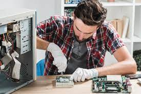 Free Photo | Young male technician wearing gloves fixing computer  motherboard with screwdriver