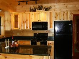 cabin kitchen countertop black granite countertops add an elegant contrast to the golden wood walls