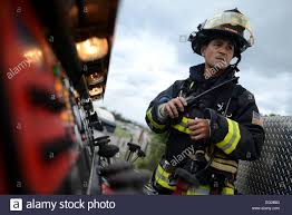 Keira Uehara 18th Civil Engineer Squadron Firefighter Listens To
