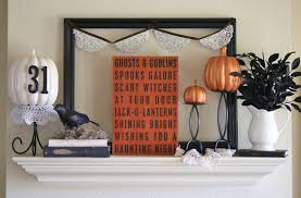 engaging sacry mantel decorations featuring black wooden frame and black crow