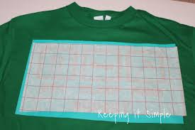 using transfer paper i put the transfer paper over the vinyl removed the backing and then put it onto the shirt you have to go slowly because there are